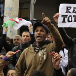 Libyan anti-government protesters chant slogans during a rally in the city of Tobruk yesterday as thousands gathered for prayers and celebrations after a UN vote approved a no-fly zone.