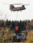 A Japanese Self Defence Force CH-47 Chinook helicopter flies in Sendai city in Miyagi