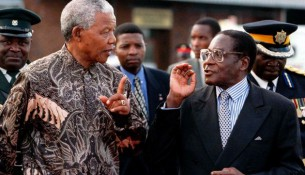 The late former South African President Nelson Mandela and his Excellency President Robert Mugabe
