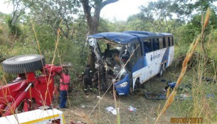 A tow truck recovers the wreckage of a King Lion bus that veered off the road and hit a tree on recently killing 45 people in Nyamakate, Hurungwe.