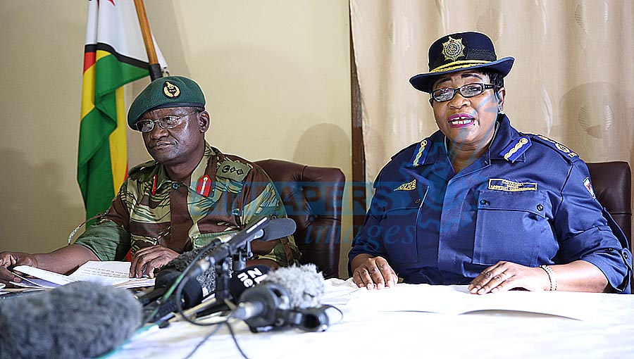 Zimbabwe Defence Forces spokesperson Colonel Overson Mugwisi (left) and Zimbabwe Republic Police chief national spokesperson Senior Assistant Commissioner Charity Charamba during a press conference held in Harare yesterday