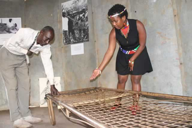 Chief executive of friends of Joshua Nkomo Trust Beverly Pullen shows Christopher Ndlovu the bed that the late Joshua Nkomo used to sleep on at Gonakudzingwa Prison in 1964-1974