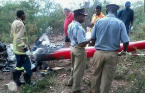 Fire Brigade and police officers attend the scene of the crash