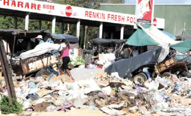 Uncollected garbage  festers outside Bulawayo's  Renkini bus terminus in this file photo