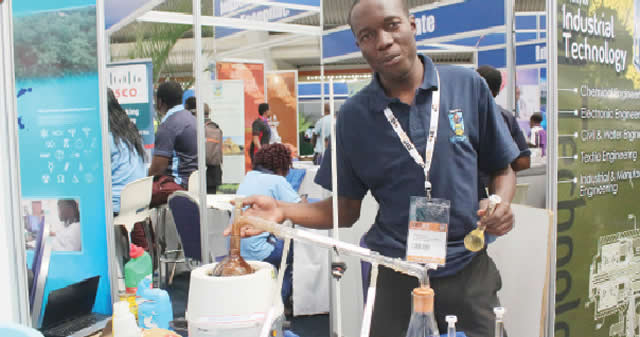 National University of Science and Technology student Farai Musendo demonstrates the process of making diesel from plastic
