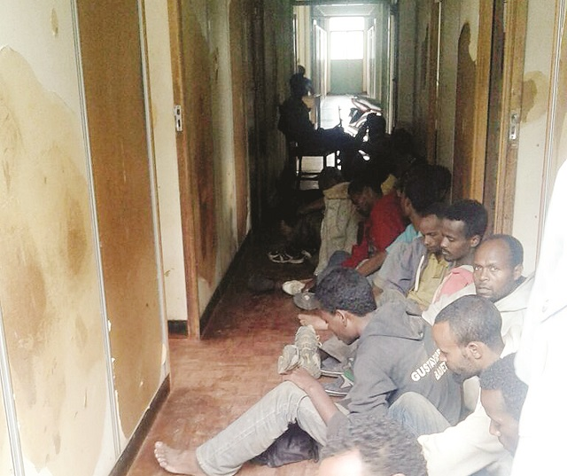 Some of the illegal Ethiopian immigrants  sitting in the corridor at the Gwanda prosecution office