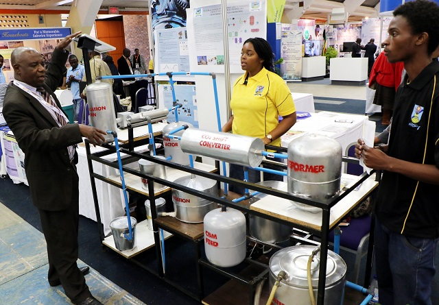 Nust's Director of Communication and Marketing Mr Felix Moyo  yesterday shows the amonium production plant that was invented by the university students which is on exhibition at this year ZITF edition.(Picture  by Eliah Saushoma)