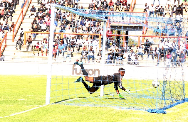 Herentals goalkeeper Frank Kuchineyi salvages the ball from the nets after Adrian Silla shot at goal at Barbourfields Stadium yesterday